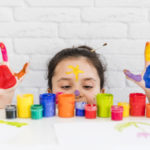 cheerful child with painted hands